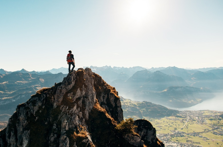 Hiker-On-Top-Of-A-Mountain